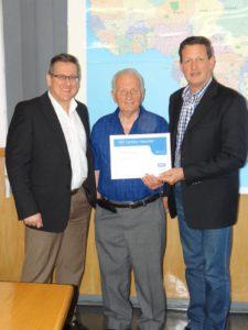 SKF's Anton Theunissen congratulates Armando and David Balocco on Delba Electrical's 5th electrical rewinder certification