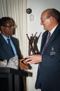 New Head of School, Professor Cuthbert Musingwini handing over the iconic 'miner' trophy in thanking Professor Fred Cawood for his contribution to the School during his 5 year tenure.