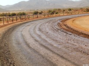 Road surface treated with the Dust-A-Side product