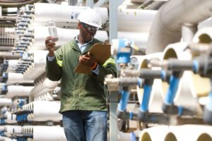 SOLLY CHOKOE is an environmental officer at the Emalaleni Water Treatment plant.  Pictured amongst the reverse osmosis tubes and inspecting the treated water in the plant