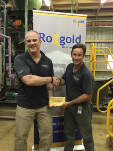 Roxgold president and CEO John Dorward and COO Paul Criddle holding the 1 020 oz gold bar