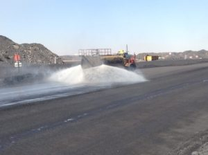 Product application on secondary haul road