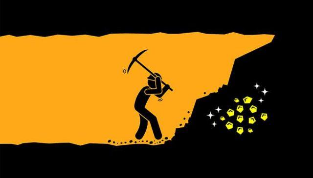 Mine worker digging for gold